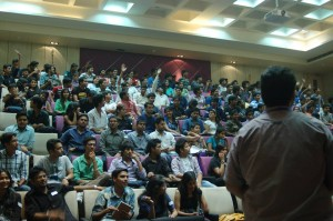 Students Raising hands to answer quiz to win goodies.